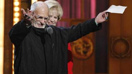 Larry Kramer, left, and Daryl Roth accept the