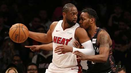 Heat shooting guard Dwyane Wade controls the ball