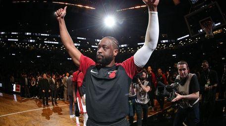 Heat shooting guard Dwyane Wade gestures towards the