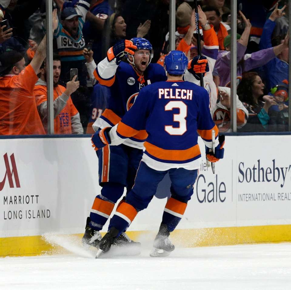 Islanders right wing Josh Bailey (12) celebrates his
