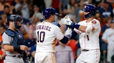 Houston Astros third baseman Yuli Gurriel (10) and