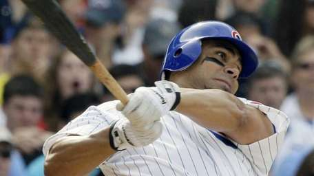 Chicago Cubs' Carlos Pena hits a two-run home