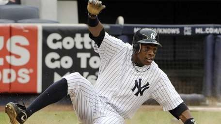 New York Yankees' Curtis Granderson scores the game-winning