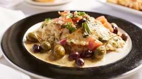 Sauteed red snapper with Kalamata olives, grape tomatoes,
