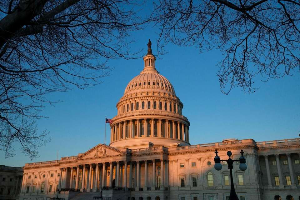 The U.S. Capitol is seen at sunrise, Saturday,