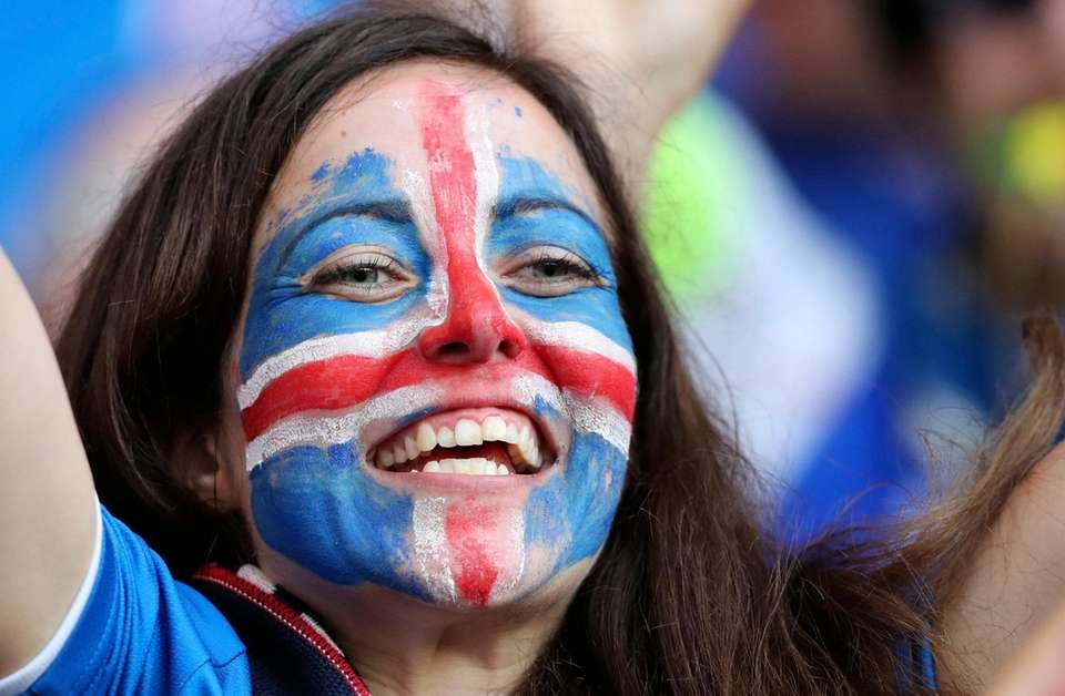 An Iceland supporter smiles prior to the Euro