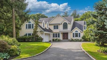 This Bayville Colonial, for $1.498 million, includes five