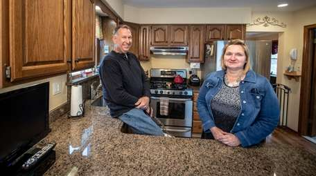 Robert and Christine Budzenski in the kitchen of