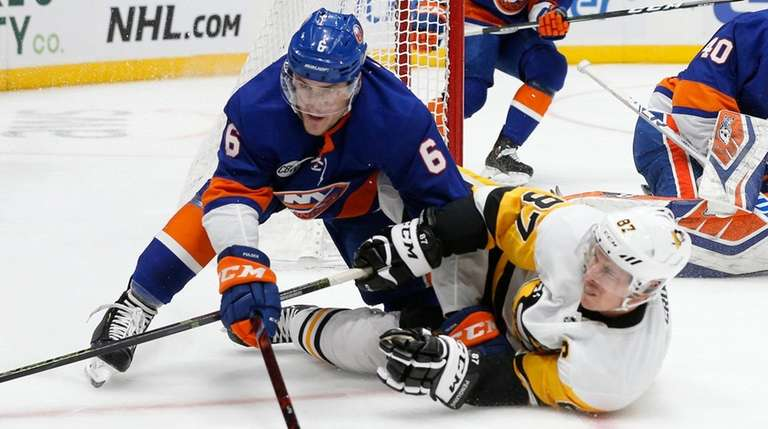 Islanders defenseman Ryan Pulock and Penguins center Sidney