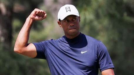 Tiger Woods of the US reacts to his