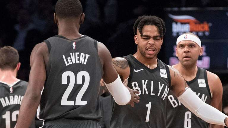 Brooklyn Nets guard D'Angelo Russell and guard Caris