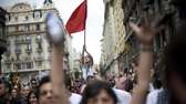 Demonstrators shout slogans during a protest against the