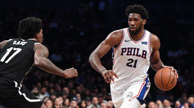 Joel Embiid of the 76ers dribbles the ball