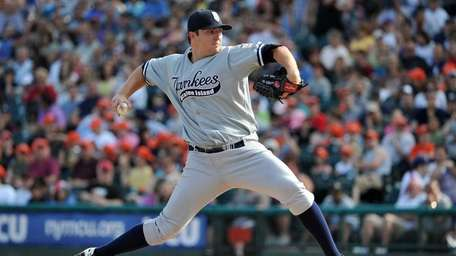 New York Yankees starting pitcher Phil Hughes throws