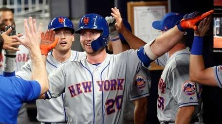 The Mets' Pete Alonso celebrates after hitting a