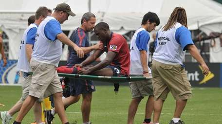 Jozy Altidore is carried off the field after