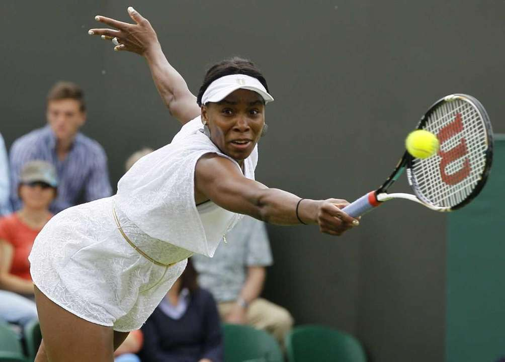 Venus Williams returns a shot to Uzbekistan's Akgul