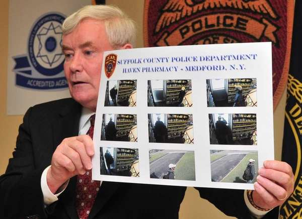 Suffolk County police commissioner Richard Dormer shows surveillance