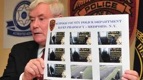 Suffolk County police commissioner Richard Dormer shows surveillance