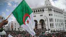 People chant slogans during a demonstration in Algiers,