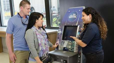 Customers get assistance from NYS-DMV associates at a