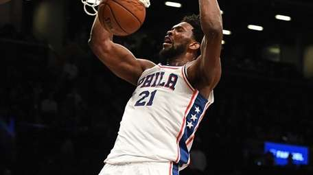 Joel Embiid of the 76ers scores two points