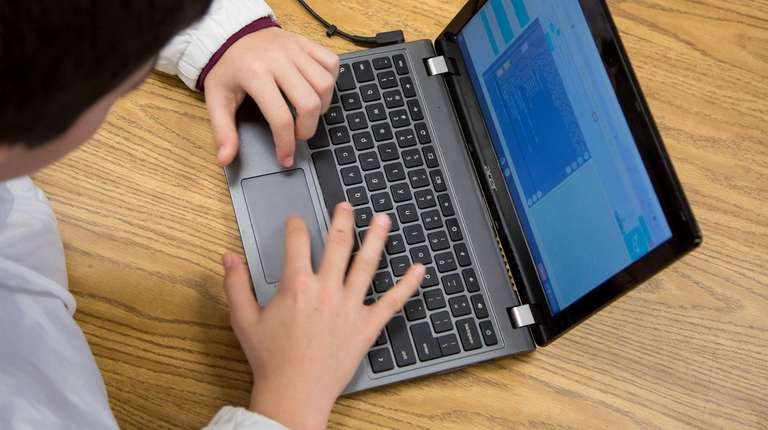 Students use Chromebooks in a class at Elwood