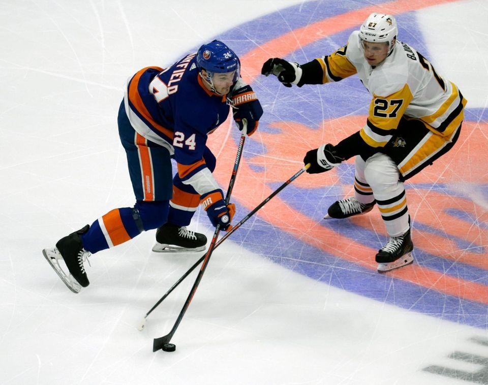Islanders defenseman Scott Mayfield (24) skates up ice
