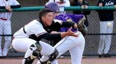 Oyster Bay's Gatti Michael slides safely ahead of