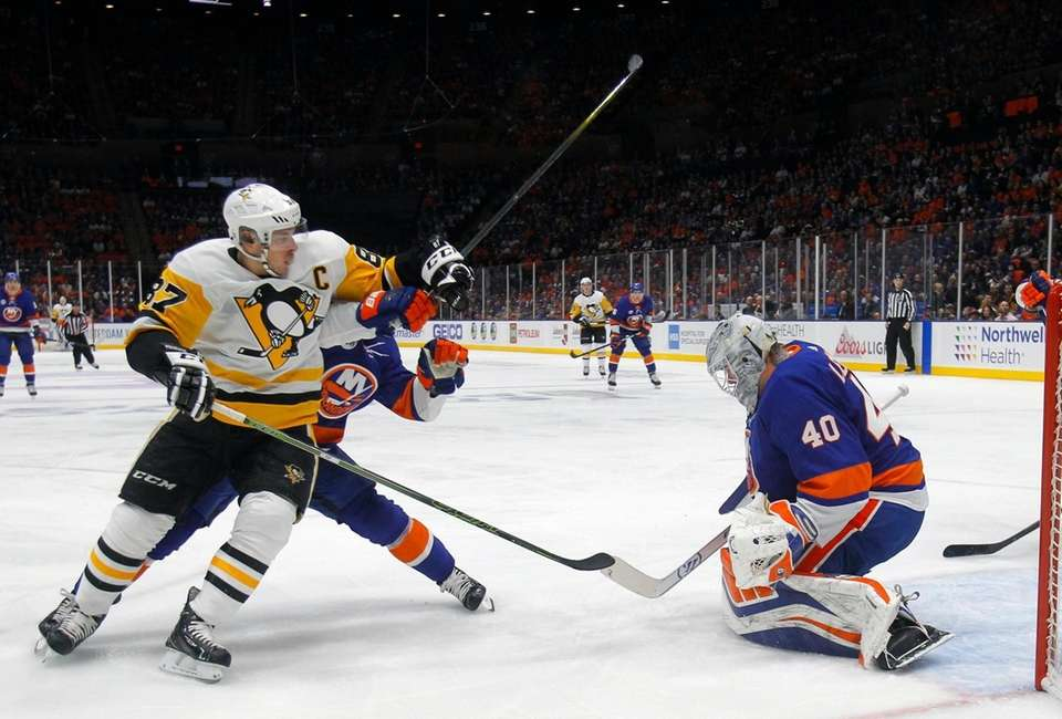 Islanders defenseman Nick Leddy (2) defends the shot