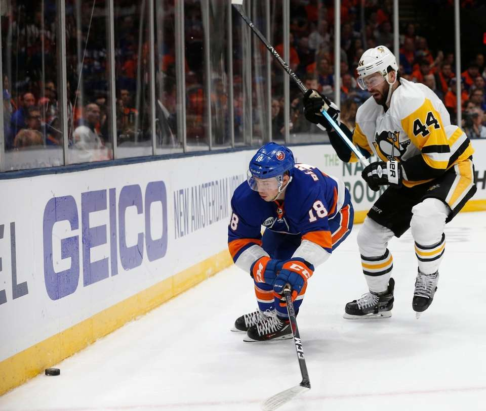 Islanders left wing Anthony Beauvillier (18) is defended