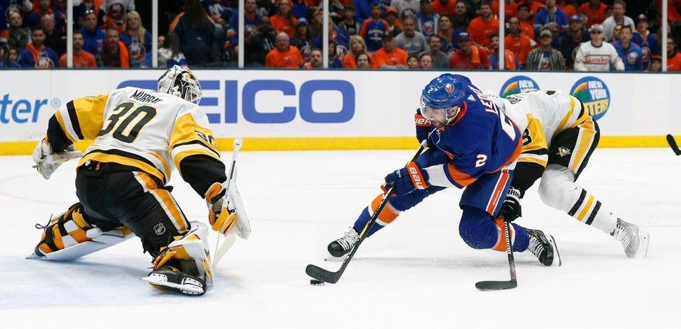 \p30 defends as Islanders defenseman Nick Leddy (2)