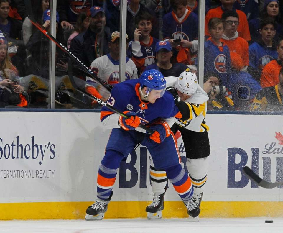 Islanders center Mathew Barzal and Penguins defenseman Brian