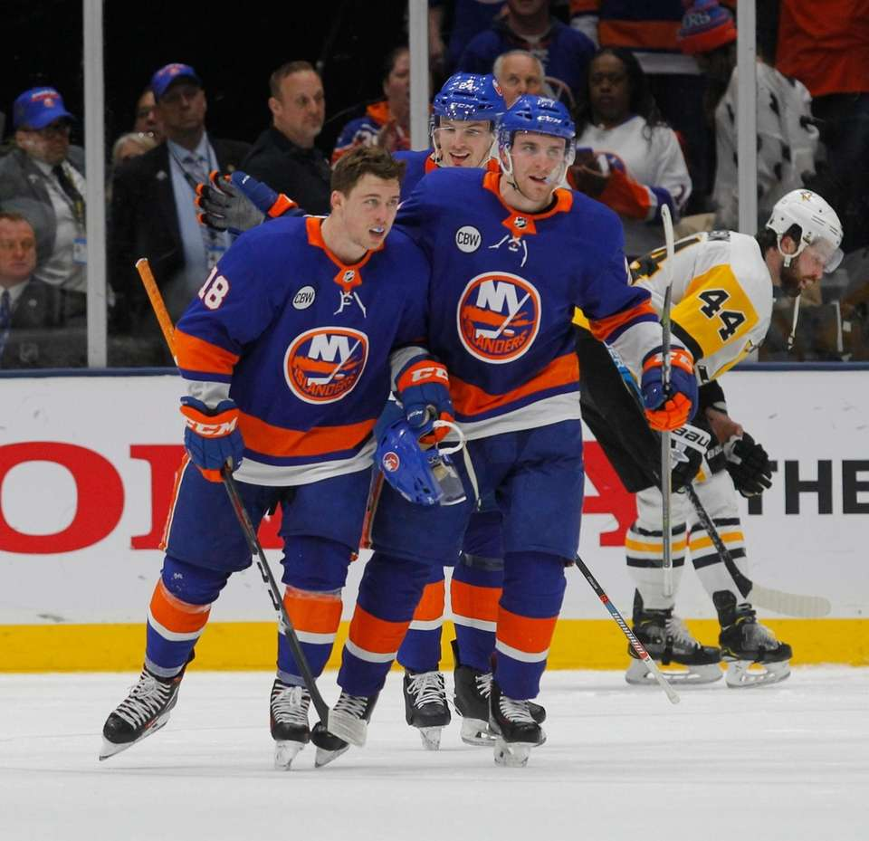 Islanders left wing Anthony Beauvillier (18) celebrates after