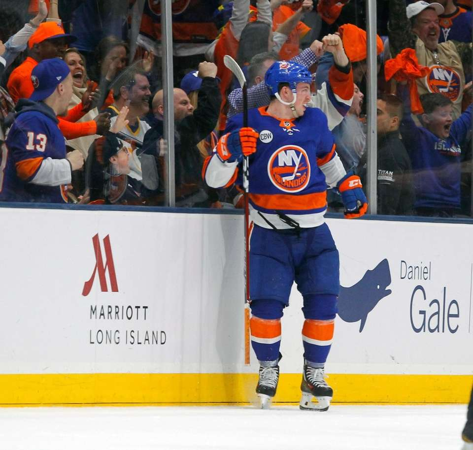 Islanders left wing Anthony Beauvillier (18) celebrates the