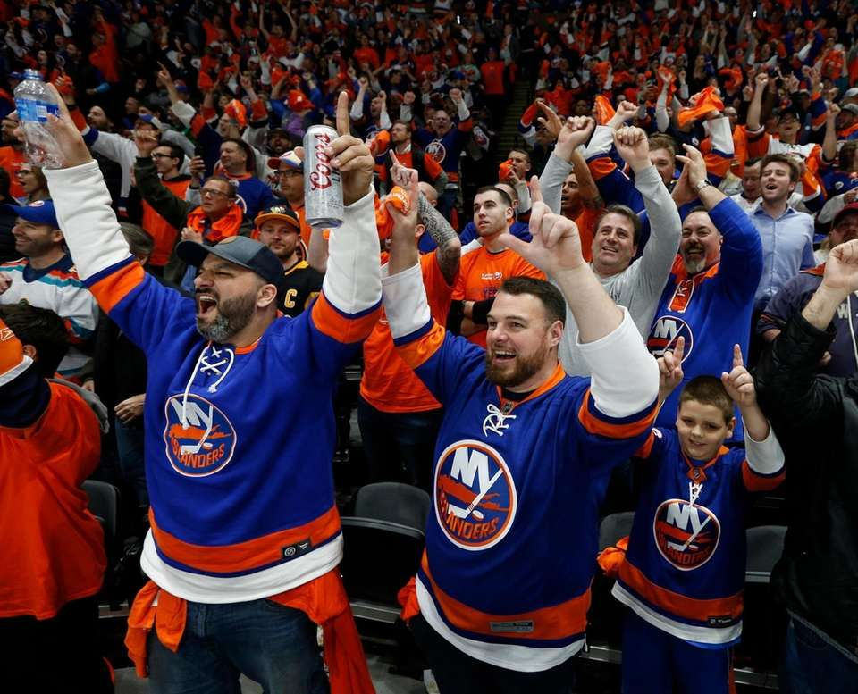 Islanders fans celebrate the goal during the second