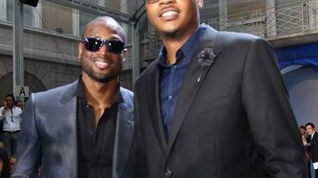 Dwayne Wade, left, and Carmelo Anthony attend the