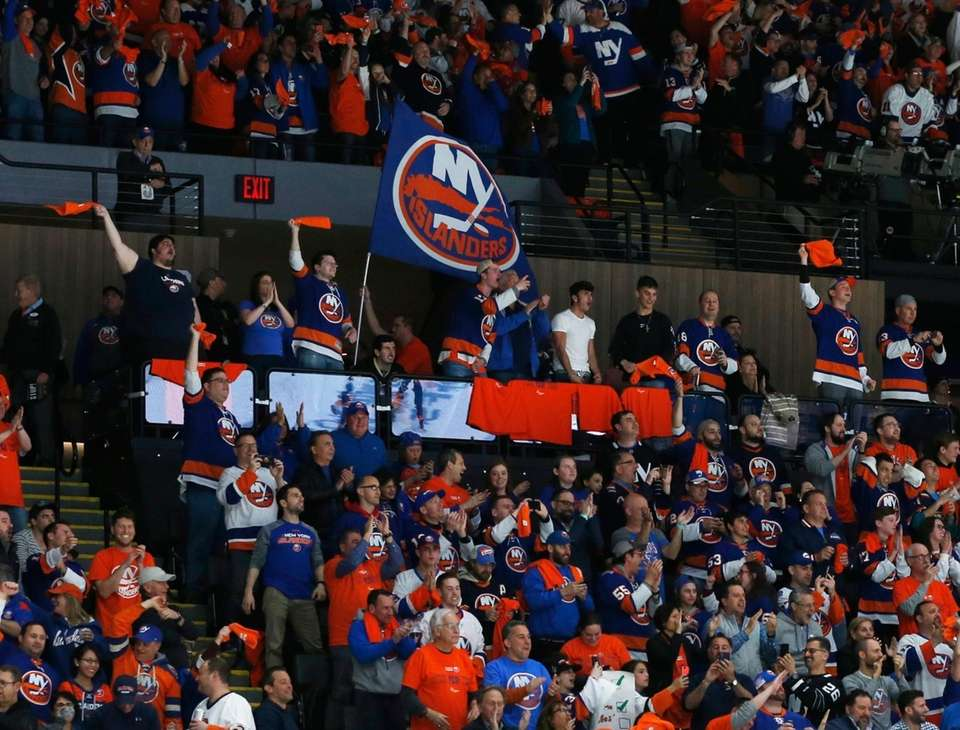 Islanders fans celebrate the third goal during the
