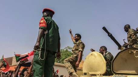 Sudanese forces celebrate on Thursday after officials said