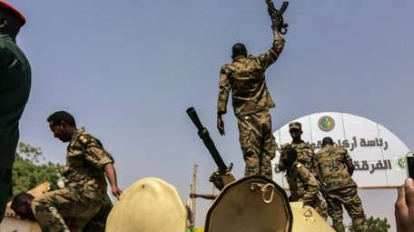 Sudanese forces celebrate after officials said the military