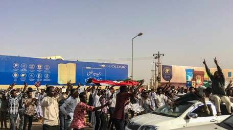 Sudanese celebrate after officials said the military had