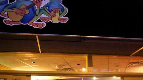 Patrons dine at Ay Que Rico restaurant in