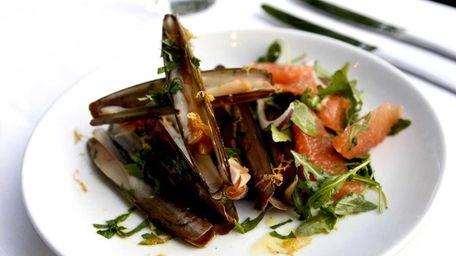 Razor clams are served with green garlic gremolata,