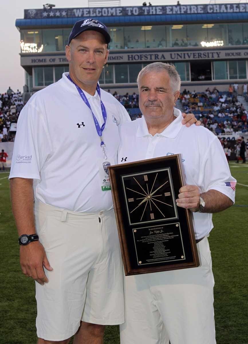 Suffolk County Coaches Association's president Hans Weiderker presents