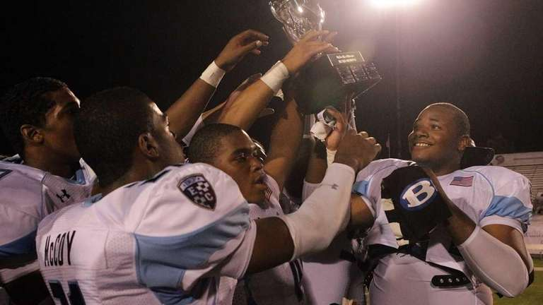 Long Island teammates hold up their winner's trophy