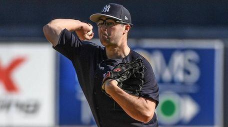 Yankees pitcher Joe Harvey throws live batting practice