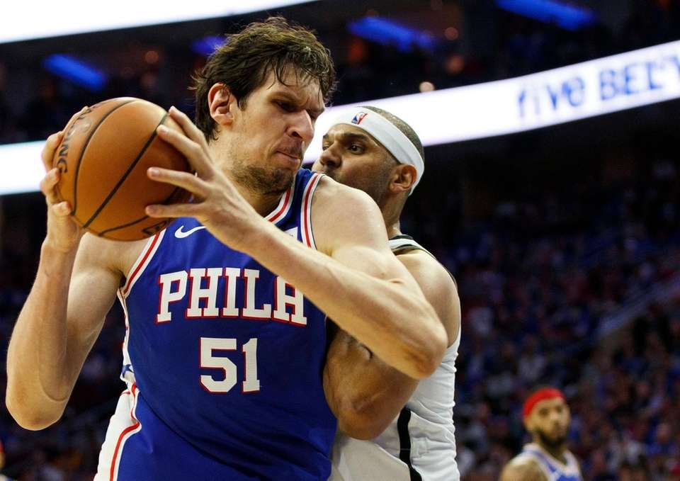 The 76ers' Boban Marjanovic, left, of Serbia, makes