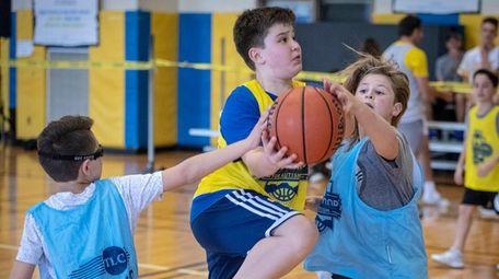 Children play basketball at
