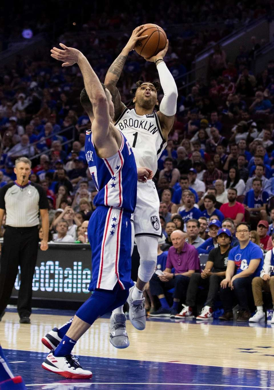 The Nets' D'Angelo Russell, right, shoots the ball
