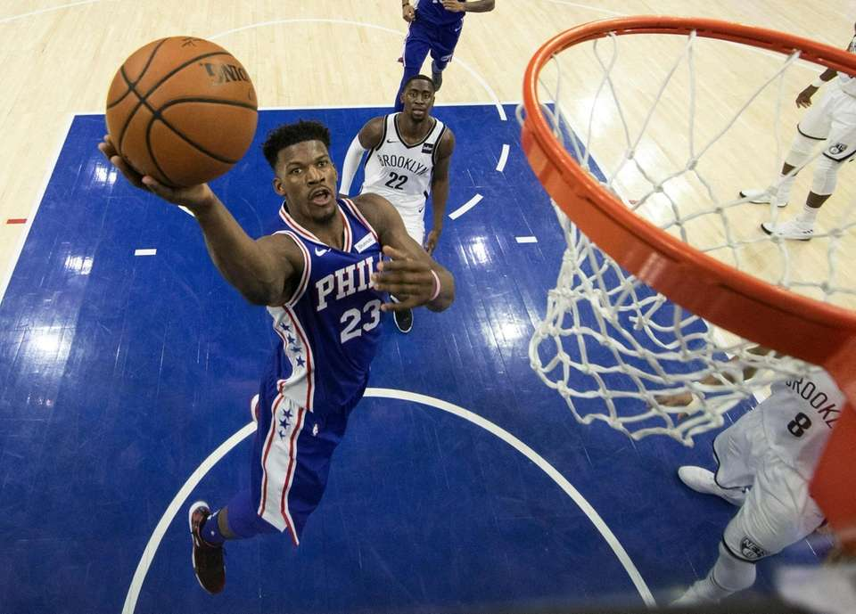 The 76ers' Jimmy Butler puts up the shot